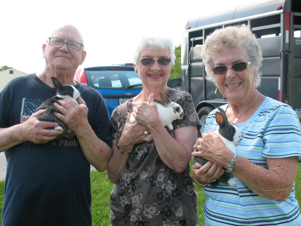 Seniors Holding Bunnies
